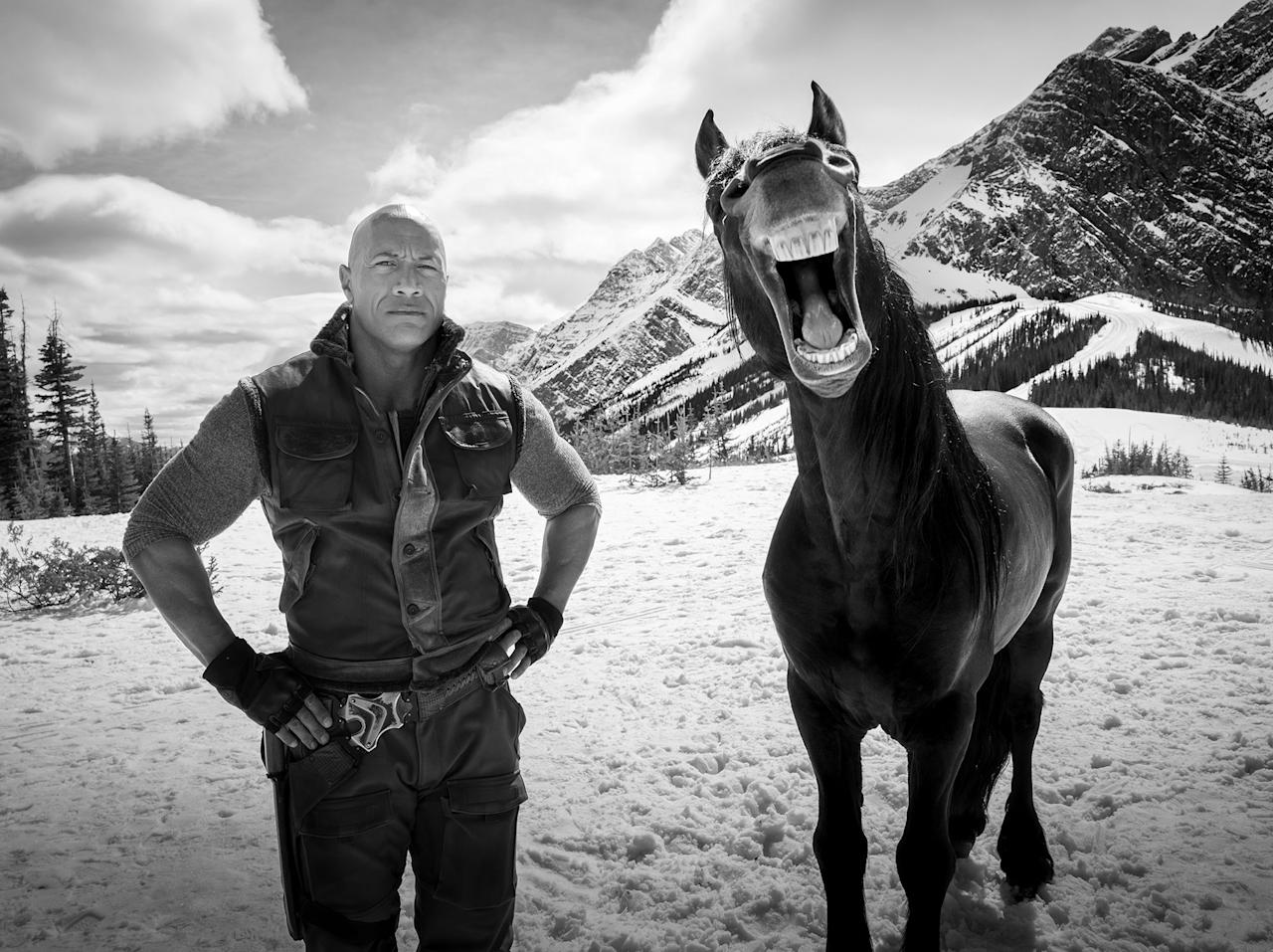 """We had two gorgeous black Friesians on set. These horses are stunning. Giant, muscular, majestic. Every angle you look at them, they're stunning, and they were really good actors,"" Garcia said. ""D.J. was standing with one, and the idea was, this was going to be a really badass shot. Like I'm going to have D.J. give me straight blue steel, the Friesian at the time was giving a real nice profile look. His face was looking to the side. And you have the mountains and the clouds…and then the shot turns into this."""