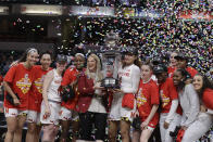 Maryland head coach Brenda Frese, center left, celebrates with her team after they defeated Ohio State to win NCAA college basketball championship game at the Big Ten Conference tournament, Sunday, March 8, 2020, in Indianapolis. (AP Photo/Darron Cummings)
