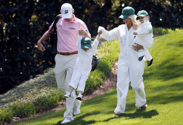 U.S. golfer Brandt Snedeker (L) walks off the first tee with his wife Mandy (2nd R) and their two children Austin (2nd L) and Lily during the Par 3 contest ahead of the Masters golf tournament at the Augusta National Golf Club in Augusta, Georgia April 9, 2014. REUTERS/Mike Segar (UNITED STATES - Tags: SPORT GOLF)