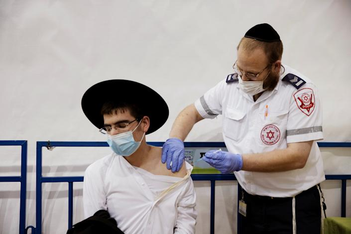 An ultra-Orthodox Jewish man receives a vaccination against the coronavirus disease (COVID-19) at a temporary vaccination centre in the Jewish settlement of Beitar Illit, in the Israeli-occupied West Bank February 16, 2021. (Ronen Zvulun/Reuters)