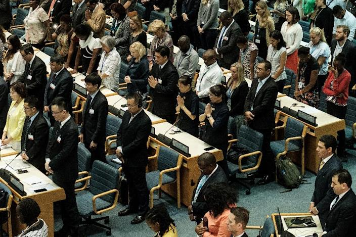 Delegates at the UN Environment Programme assembly held a minute's silence for the victims (AFP Photo/Yasuyoshi CHIBA)