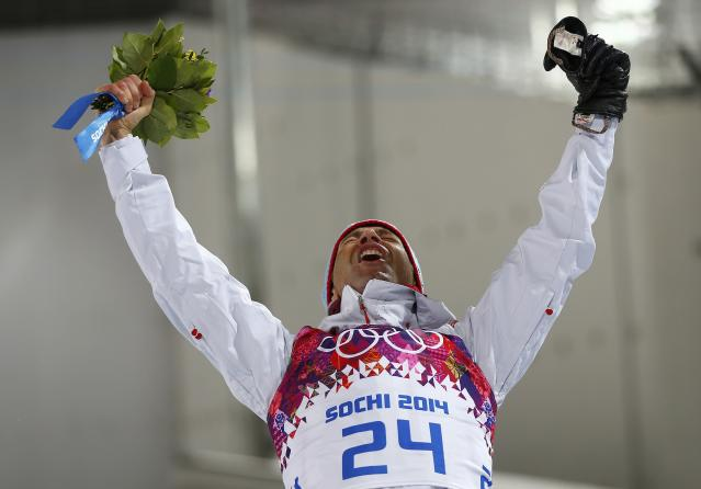 Winner Ole Einar Bjoerndalen of Norway celebrates during the flower ceremony for the men's biathlon 10 km sprint event at the Sochi 2014 Winter Olympics in Rosa Khutor February 8, 2014. REUTERS/Carlos Barria (RUSSIA - Tags: SPORT BIATHLON OLYMPICS)