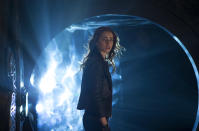 """This film publicity image released by Screen Gems shows Lilly Collins as Clary in a scene from """"The Mortal Instruments: City of Bones."""" (AP Photo/Sony Pictures Screen Gems, Rafy)"""