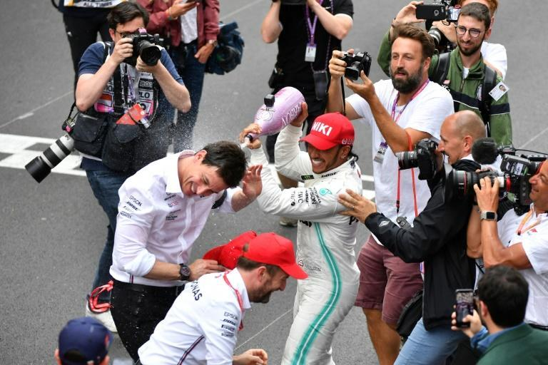 Teamwork: Lewis Hamilton pours champagne over Mercedes team principal Toto Wolff after the 2019 Monaco Grand Prix