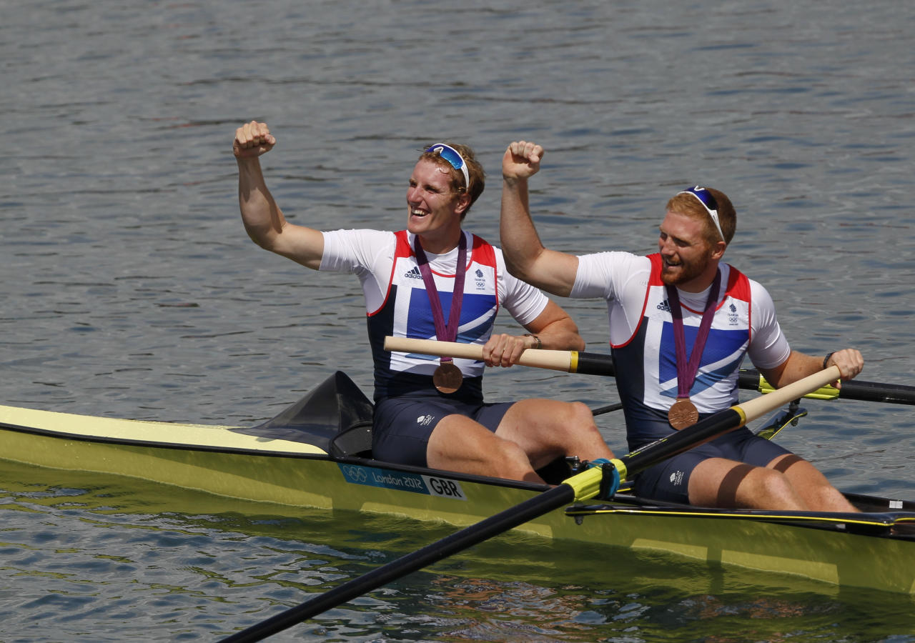 Bronze medallists George Nash and William Satch (R) of Britain pose after the medals ceremony for the Men's Pair Final event during the London 2012 Olympic Games at Eton Dorney August 3, 2012.             REUTERS/Mark Blinch (BRITAIN  - Tags: OLYMPICS SPORT ROWING)