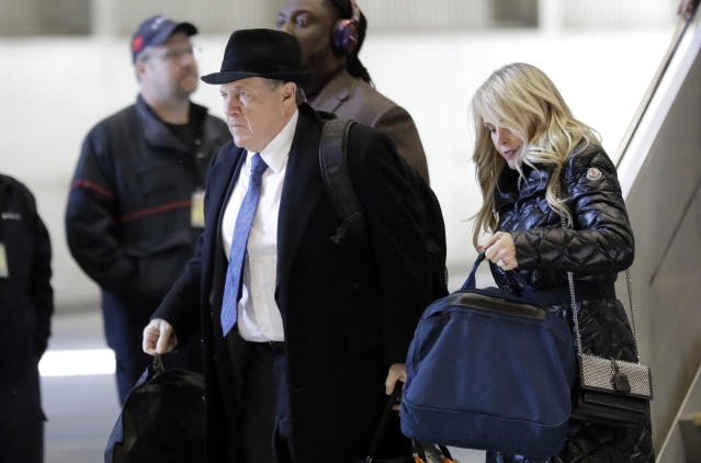 New England Patriots head coach Bill Belichick, left, arrives with his wife Debby, right, and team for the NFL Super Bowl 52 football game Monday, Jan. 29, 2018, in Minneapolis. New England is scheduled to face the Philadelphia Eagles Sunday. (AP Photo/Eric Gay)
