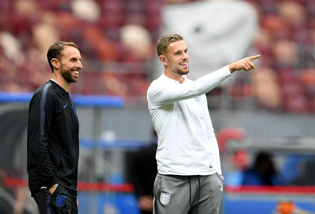 Gareth Southgate and Jordan Henderson, possibly pointing out a suspicious observer.