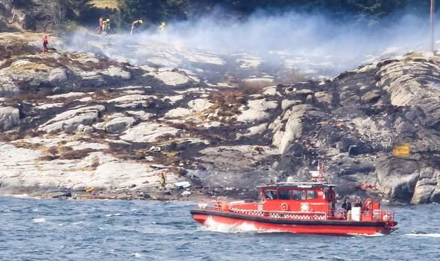 Rescue workers have said they are continuing their search in the hope of finding survivors, after a helicopter carrying 13 people crashed of the west coast of Norway.