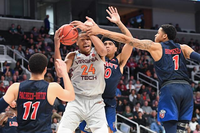 <p>Kerry Blackshear Jr. #24 of the Virginia Tech Hokies fights for possession against the Liberty Flames in the second round of the 2019 NCAA Men's Basketball Tournament held at SAP Center on March 24, 2019 in San Jose, California. (Photo by Justin Tafoya/NCAA Photos via Getty Images) </p>