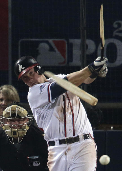 Atlanta Braves' Chris Johnson hits a broken-bat single against the Los Angeles Dodgers in the seventh inning of Game 2 of the National League division series on Friday, Oct. 4, 2013, in Atlanta. (AP Photo/Dave Martin)