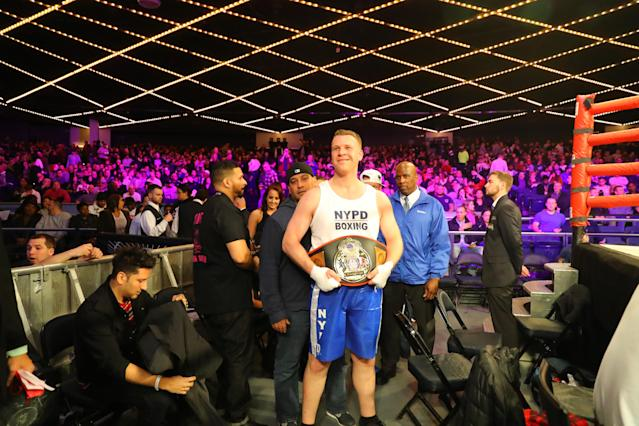 Steve Merslich (red) shows off championship belt after defeating Francis Torres (blue) in Baseball Team Grudge match in the NYPD Boxing Championships at the Hulu Theater at Madison Square Garden on March 15, 2018. (Gordon Donovan/Yahoo News)