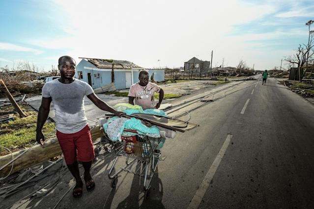 "<div class=""caption""> Two Haitian cousins say they had lost everything and have no place to go. ""Without papers"" they feared heading to Nassau because of the potential of being sent back to Haiti. </div> <cite class=""credit"">Dom Furore</cite>"