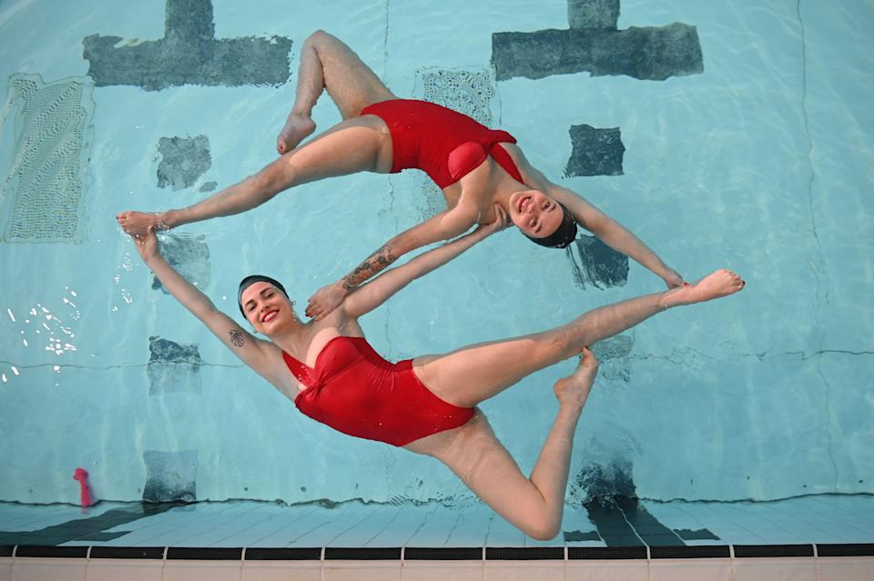 Members of Aquabatix, a synchronised swimming team practice at Clissold leisure centre in north London as coronavirus restrictions are eased across the country following England's third national lockdown on April 12, 2021. (Photo by DANIEL LEAL-OLIVAS / AFP) (Photo by DANIEL LEAL-OLIVAS/AFP via Getty Images)