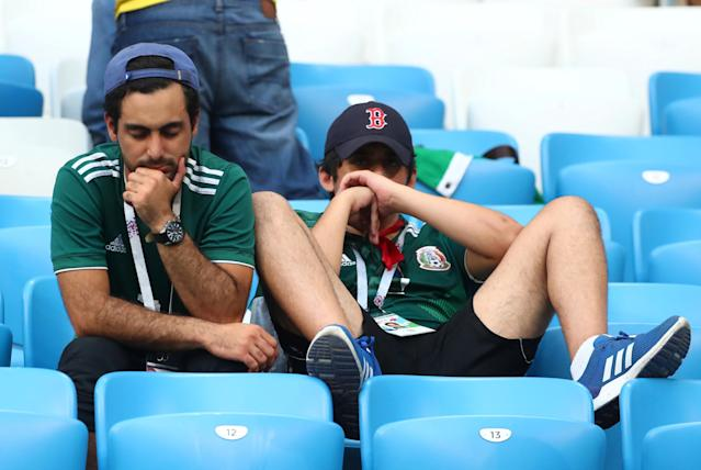 <p>Mexico fans look dejected after the match REUTERS/Pilar Olivares </p>