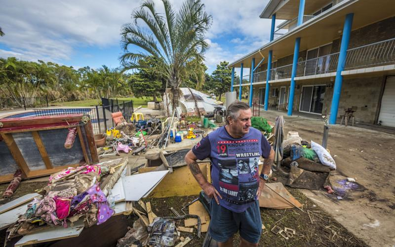 Volunteer Alan Dear helps clean up a property at Eagleby that was damaged by flood water on April 3, 2017 - Credit: Glenn Hunt/Getty Images