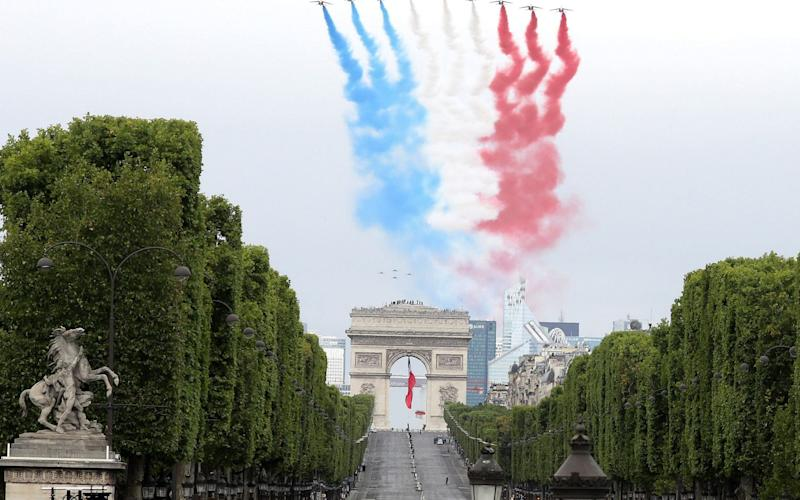 Bastille Day military parade in Paris, France - Shutterstock