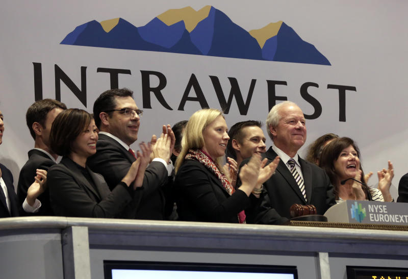 Intrawest Resorts Holdings CEO William Jensen, second from right, is applauded as he rings the New York Stock Exchange opening bell, to mark his company's IPO, Friday, Jan. 31, 2014. Denver-based Intrawest is a mountain resort and adventure company. (AP Photo/Richard Drew)