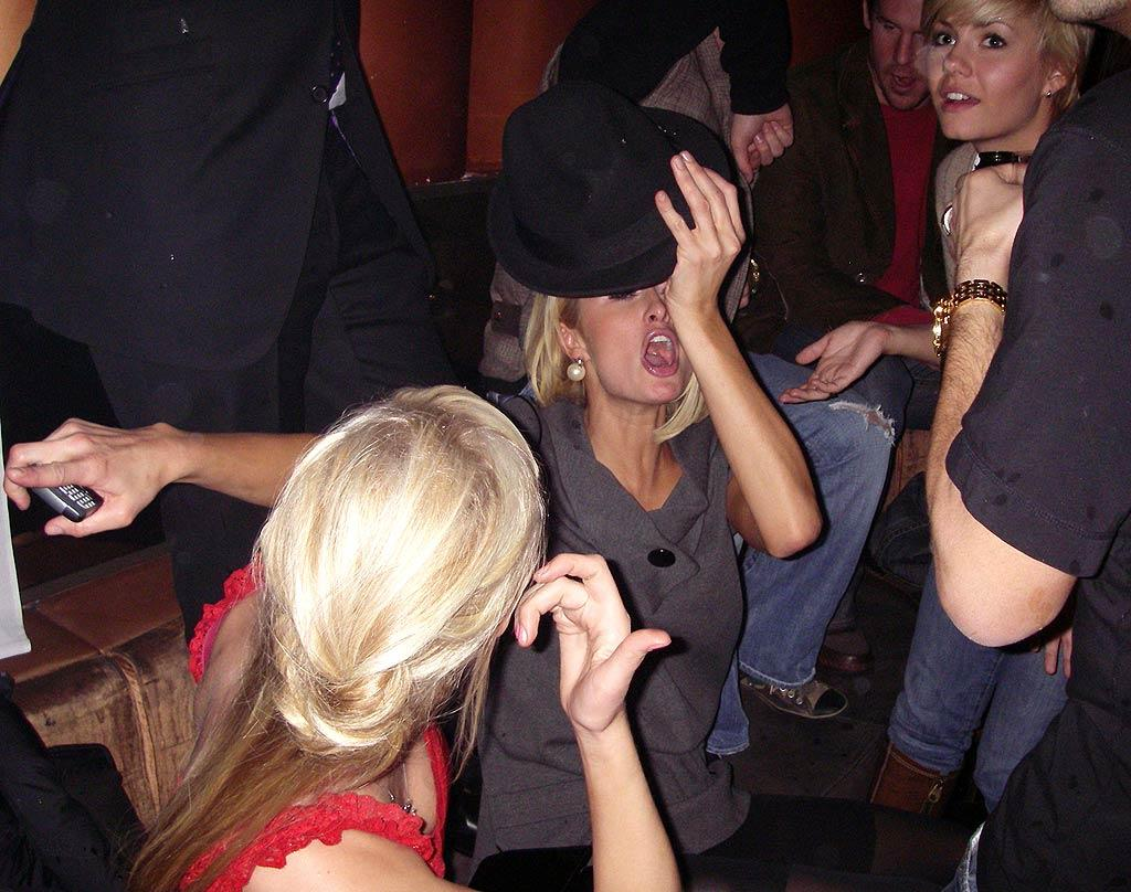 """Paris Hilton gets her groove on at Club Tenjune while BFF Elisha Cuthbert looks on. Jose Perez/<a href=""""http://www.infdaily.com"""" target=""""new"""">INFDaily.com</a> - January 29, 2008"""