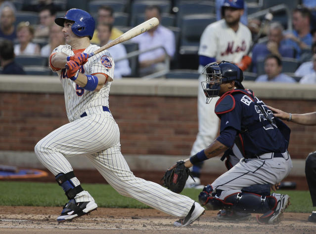 New York Mets' David Wright (5) follows through on a base hit to drive in Daniel Murphy for a run against the Atlanta Braves in the second inning of a baseball game, Tuesday, July 8, 2014, in New York. (AP Photo/Julie Jacobson)