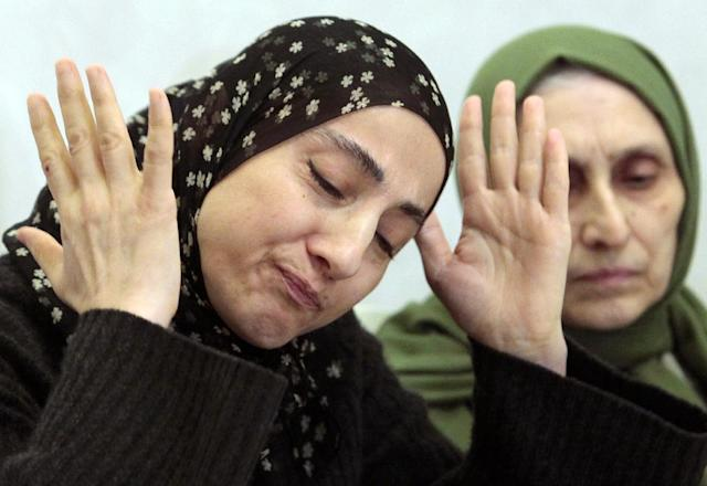 Zubeidat Tsarnaeva, the mother of the two Boston bombing suspects, speaks at a news conference as her sister-in-law, Maryam, listens in Makhachkala, in the southern Russian province of Dagestan, Thursday, April 25, 2013. The suspects' father, Anzor Tsarnaev, said Thursday that he is leaving Russia for the United States in the next day or two, but their mother said she was still thinking it over. (AP Photo/Musa Sadulayev)