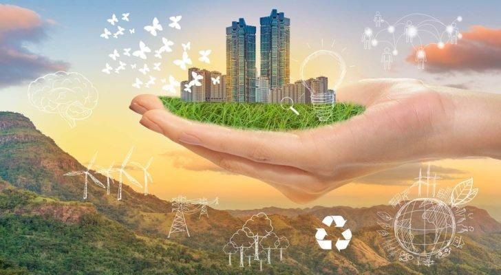 A digital animation of a hand holding a city with recycling and renewable energy symbols in the background.