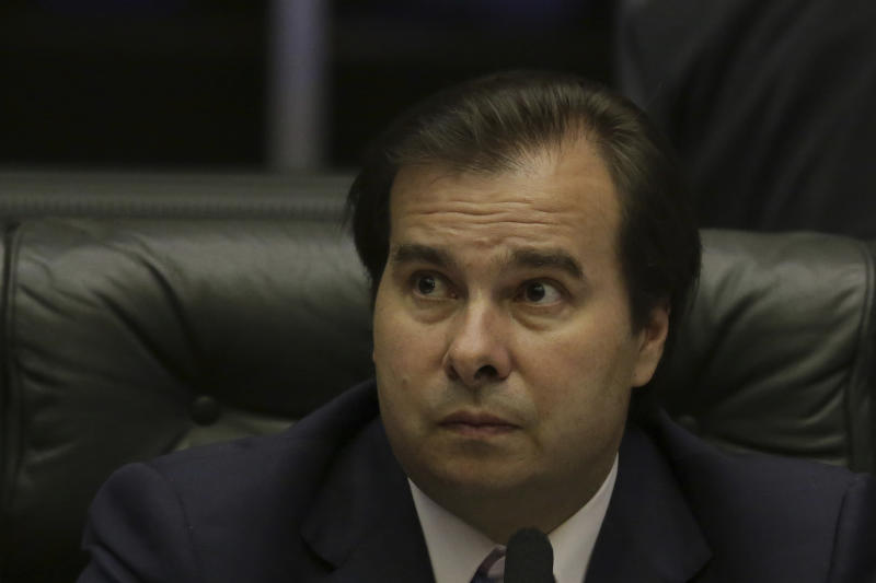 Brazil's President of the Chamber of Deputies Rodrigo Maia, looks on during a a congressional hearing before the key vote by the lower house on whether to suspend President Michel Temer and put him on trial over an alleged bribery scheme, in Brasilia, Brazil, Wednesday, Oct. 25, 2017. This is the second time Temer faces such a vote and is one more in a litany of scandals that have dogged his presidency since he replaced President Dilma Rousseff, who was impeached and removed from office last year. (AP Photo/Eraldo Peres)