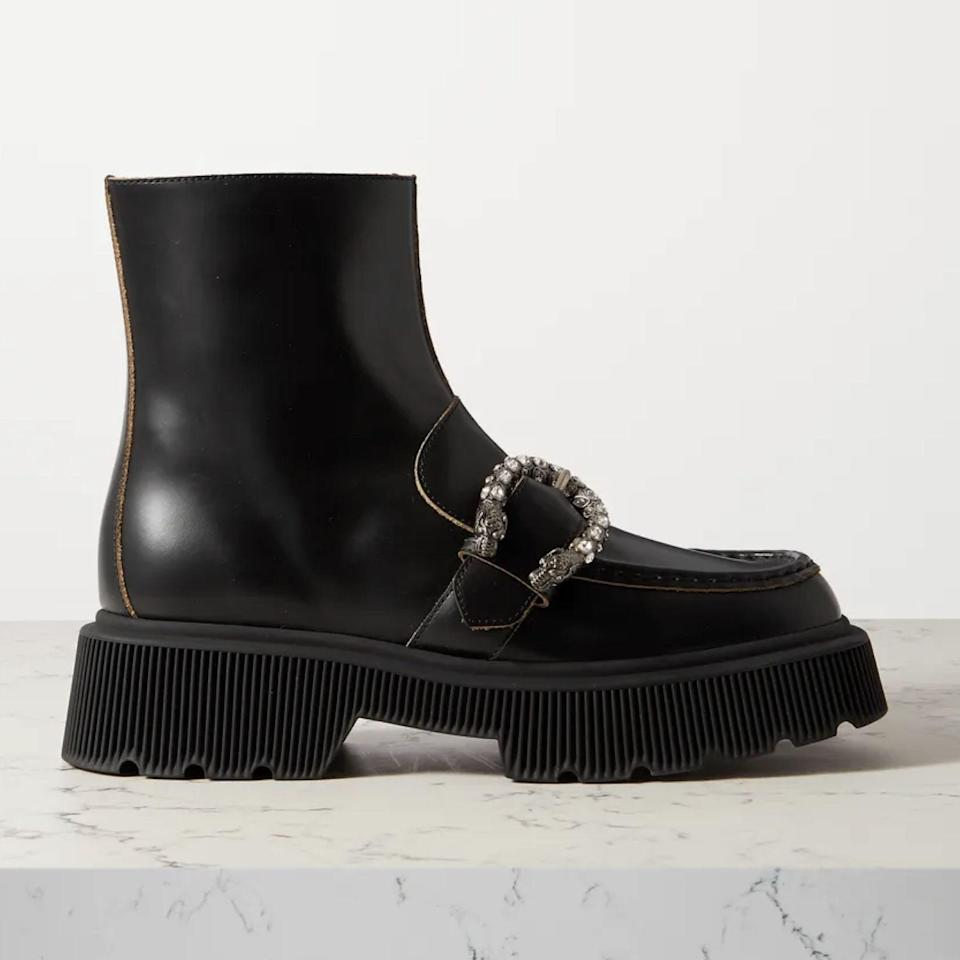 """If you're feeling extra and have a surplus of Christmas money lying around, go with this head-turning boot from Gucci, featuring a rhinestone-encrusted buckle. $1100, Net-a-Porter. <a href=""""https://www.net-a-porter.com/en-us/shop/product/gucci/hunder-buckled-leather-platform-ankle-boots/1255789"""" rel=""""nofollow noopener"""" target=""""_blank"""" data-ylk=""""slk:Get it now!"""" class=""""link rapid-noclick-resp"""">Get it now!</a>"""
