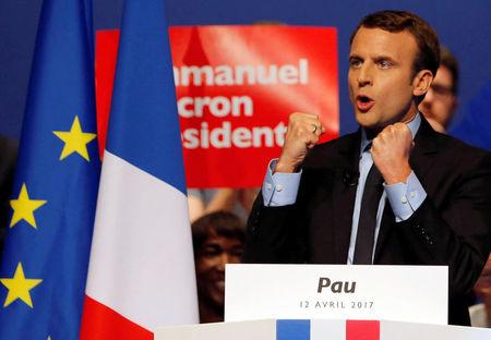 Emmanuel Macron, head of the political movement En Marche! (Onwards!) and candidate for the 2017 presidential election, delivers his speech during a campaign rally in Pau, France, April 12, 2017. REUTERS/Regis Duvignau