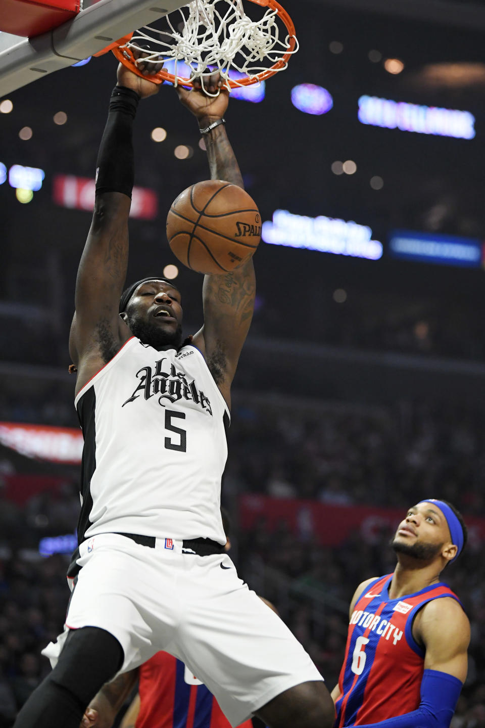 Los Angeles Clippers forward Montrezl Harrell dunks as Detroit Pistons guard Bruce Brown watches during the first half of an NBA basketball game Thursday, Jan. 2, 2020, in Los Angeles. (AP Photo/Mark J. Terrill)
