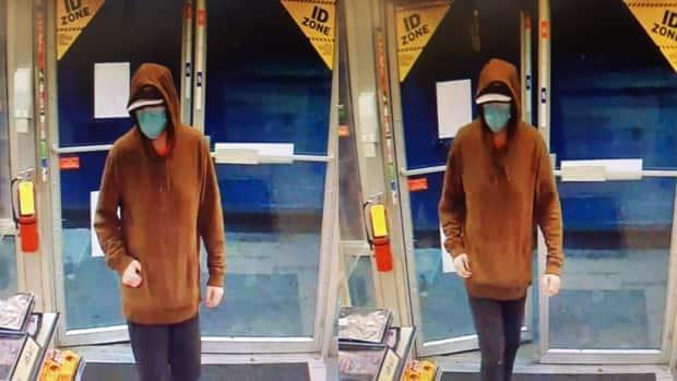 Calgary police say the man pictured above was charged in connection to three commercial robberies that occurred Saturday, and faces additional charges in nine previous robberies.  (Calgary Police Service - image credit)
