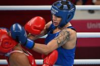 <p>Russia's Liudmila Vorontsova (red) and Italy's Irma Testa fight during their women's feather (54-57kg) preliminaries boxing match during the Tokyo 2020 Olympic Games at the Kokugikan Arena in Tokyo on July 24, 2021. / AFP / Luis ROBAYO</p>
