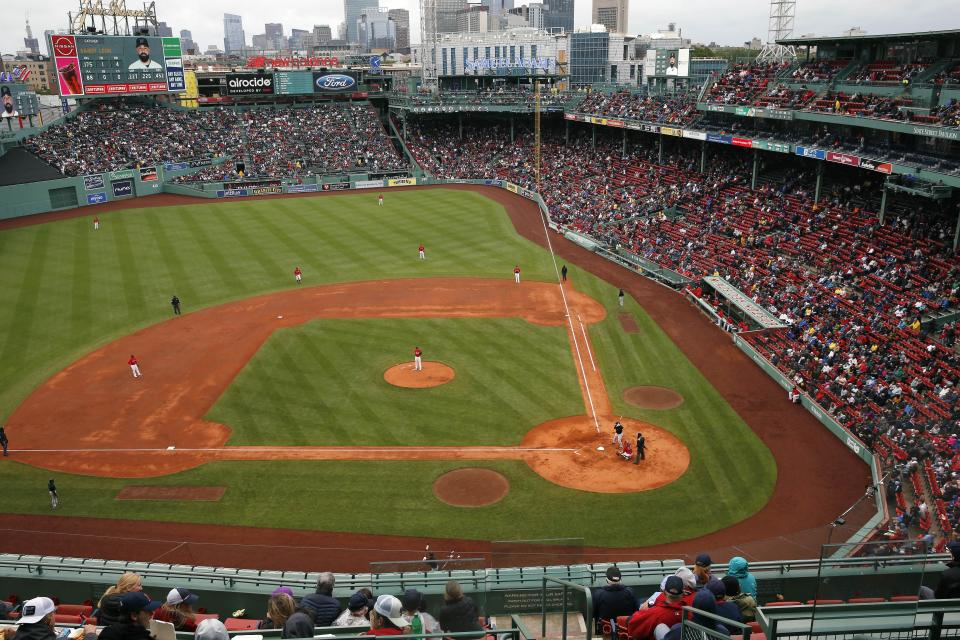The Boston Red Sox play against the Miami Marlins during the third inning of a baseball game, Saturday, May 29, 2021, in Boston. Saturday marks the end of most COVID-19 restrictions in Massachusetts. (AP Photo/Michael Dwyer)