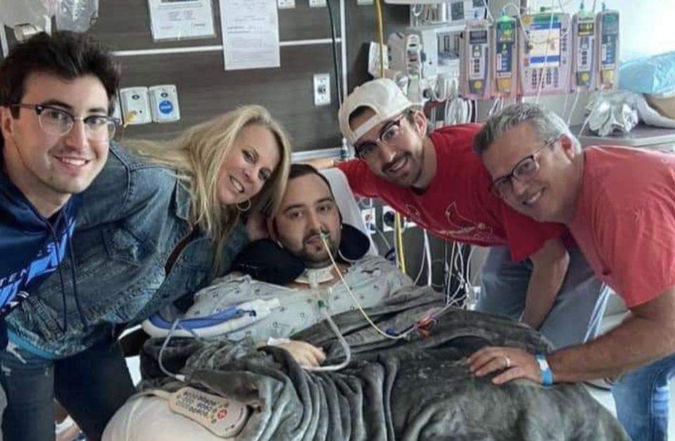 Blake Bargatze, 24, is pictured with family in hospital.