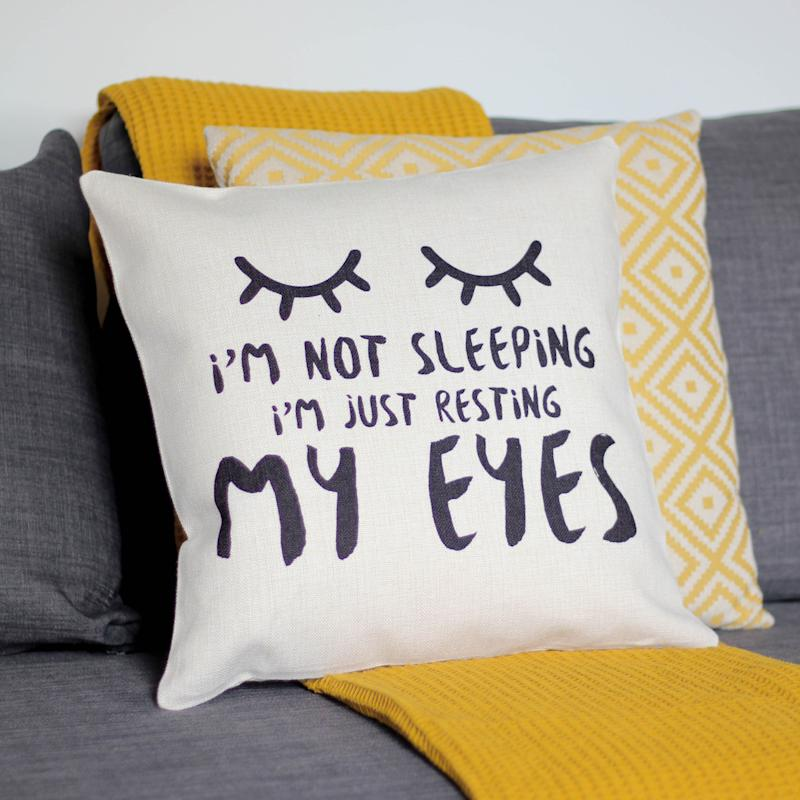 """<a href=""""https://fave.co/2OLHR9R"""" target=""""_blank"""" rel=""""noopener noreferrer"""">I&rsquo;m Not Sleeping Just Resting My Eyes Cushion, That&rsquo;s Nice That, Not On The High Street,</a> &pound;24.95 (Photo: Huffington Post UK )"""