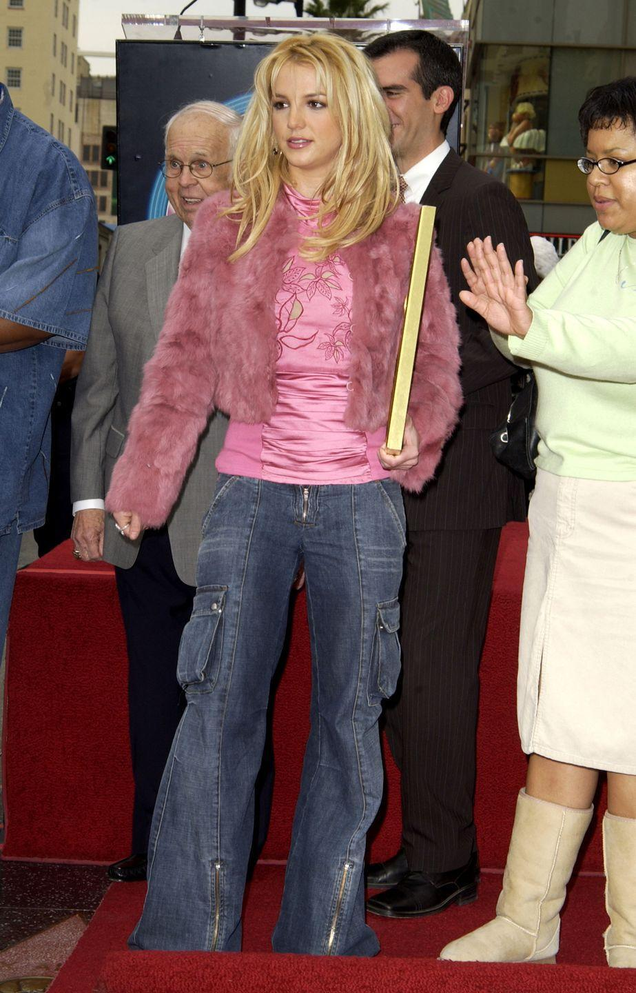 <p>And Britney also wore <em>this</em> (a.k.a. baggy denim cargo pants!!!) to receive her star on the Hollywood Walk of Fame. Had she not already earned the accolade, this outfit is proof enough of DGAF fame.</p>