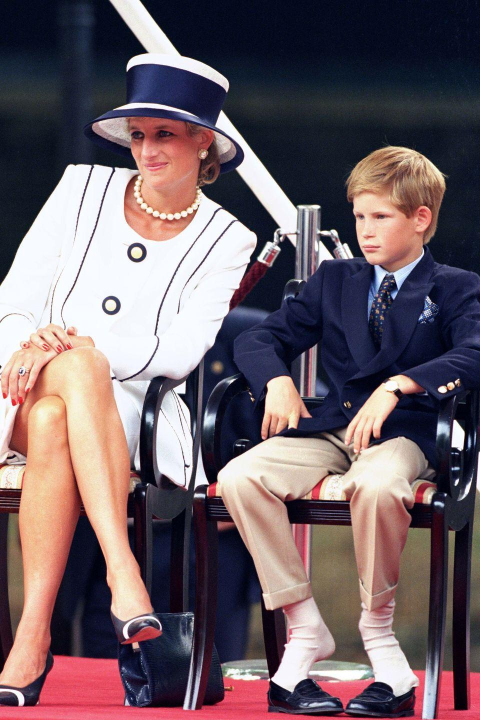 <p>Harry takes his shoes off at the V-J Day 50th anniversary celebrations in London with Princess Diana. </p>