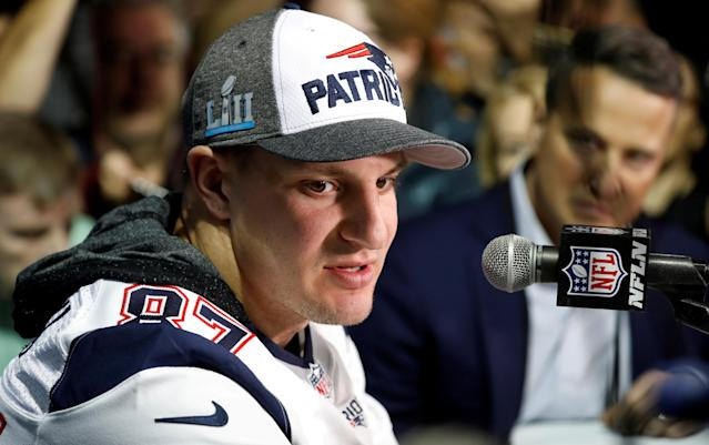 FILE PHOTO: New England Patriots tight end Rob Gronkowski speaks after being cleared from concussion protocol and will likely play in this weekend's Super Bowl in Minneapolis, Minnesota, U.S. February 1, 2018. REUTERS/Kevin Lamarque/File Photo