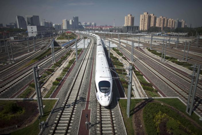 A CRH high-speed train leaves the Beijing South Station for Shanghai during a test run on the Beijing-Shanghai high-speed railway in Beijing, Monday, June 27, 2011. China's bullet train builders have conducted a test run of their showcase Beijing-to-Shanghai line amid controversy over the system's high cost. (AP Photo/Alexander F. Yuan)