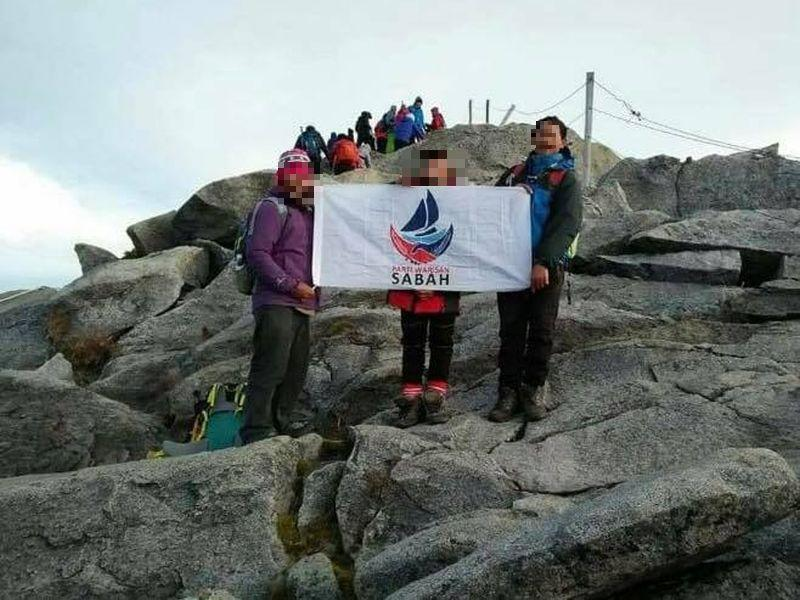 Mountain guides Jomuis Binte, 54, John Nusip Siur, 50, and Ramin Bigul, 49, caused a stir on social media after posting the photo on Facebook.
