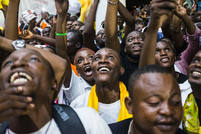 Supporters of newly re-elected Congo President Denis Sassou Nguesso celebrate his victory in Brazzaville on March 24, 2016 (AFP Photo/Eduardo Soteras)
