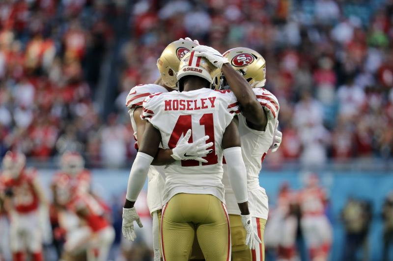 Ahkello Witherspoon, Emmanuel Moseley and D.J. Reed Jr. huddle before the Super Bowl.