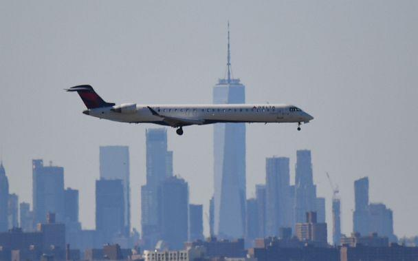 PHOTO: A plane from Delta airline is seen above the skyline of Manhattan before it lands at JFK airport in New York, March 15, 2020. (AFP via Getty Images, FILE)