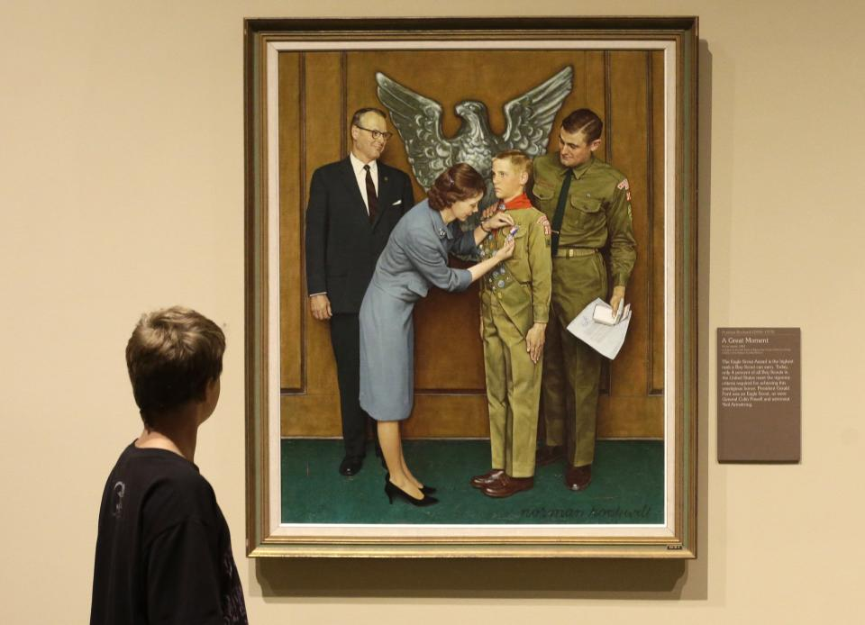 FILE - This July 22, 2013, file photo shows one of the twenty-three original, Boy Scout-themed Norman Rockwell paintings during an exhibition at the Church History Museum in Salt Lake City, Utah. The Boy Scouts of America has filed for bankruptcy protection as it faces a barrage of new sex-abuse lawsuits. The filing Tuesday, Feb. 18, 2020, in Wilmington, Del., is an attempt to work out a potentially mammoth compensation plan for abuse victims that will allow the 110-year-old organization to carry on. (AP Photo/Rick Bowmer, File)