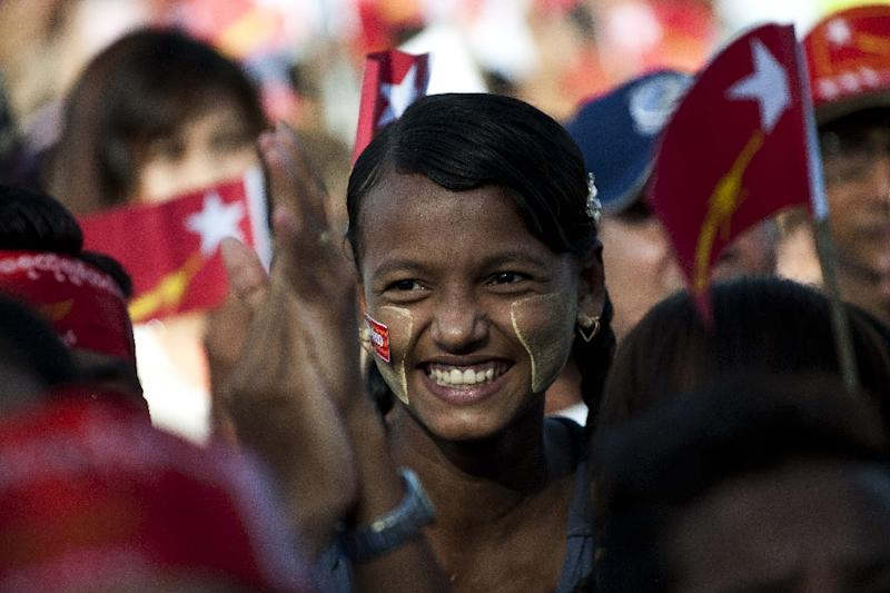 A supporters looks on as Myanmar pro-democracy leader Aung San Suu Kyi delivers her address at a rally at Mawlamyaing, Mon State on May 16, 2015