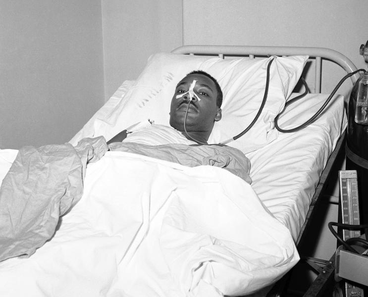 FILE - In this Sept. 21, 1958 file photo, Martin Luther King Jr. recovers from surgery in bed at New York's Harlem Hospital on following an operation to remove steel letter opener from his chest after being stabbed by a mentally disturbed woman as he signed books in Harlem. On Friday, Jan. 24, 2020, The Associated Press reported on the photo circulating online, which was accompanied by false posts claiming King was alive in a hospital bed after he was shot in 1968 and then later suffocated with a pillow. The photo was taken 10 years before the civil rights leader was assassinated on April 4, 1968. (AP Photo/John Lent, File)