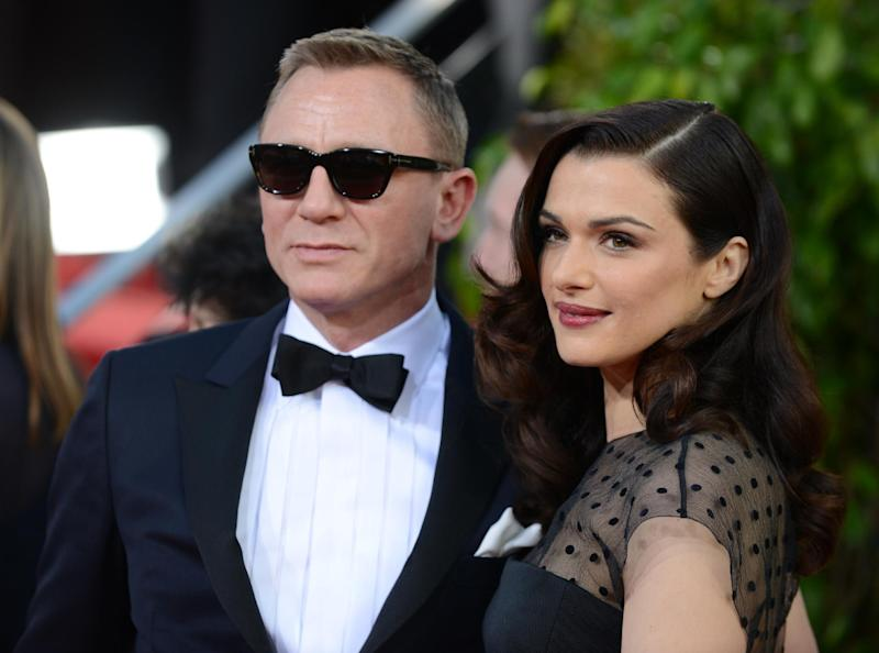 """FILE - This Jan. 13, 2013 file photo shows Daniel Craig, left, and his wife Rachel Weisz at the 70th Annual Golden Globe Awards in Beverly Hills, Calif. Craig and Weisz will star in the play """"Betrayal,"""" in October. (Photo by Jordan Strauss/Invision/AP, File)"""
