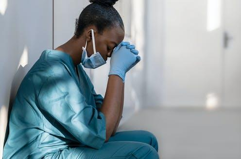 """<span class=""""caption"""">Healthcare workers' mental health is suffering during the pandemic.</span> <span class=""""attribution""""><a class=""""link rapid-noclick-resp"""" href=""""https://www.shutterstock.com/image-photo/tired-depressed-female-african-scrub-nurse-1761627959"""" rel=""""nofollow noopener"""" target=""""_blank"""" data-ylk=""""slk:Shutterstock.com"""">Shutterstock.com</a></span>"""