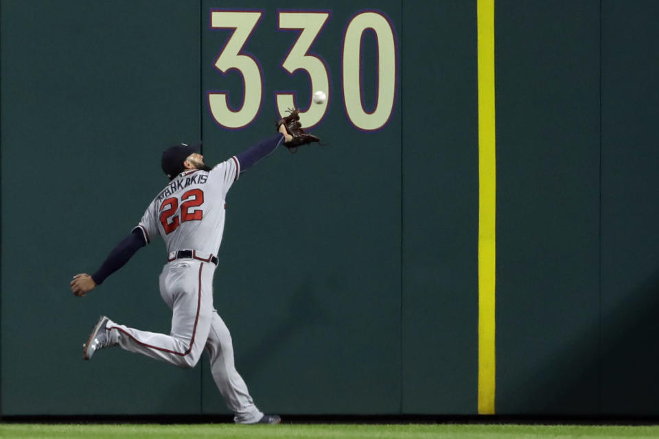 Atlanta Braves right fielder Nick Markakis catches a fly out by Philadelphia Phillies' Rhys Hoskins during the fourth inning of a baseball game, Wednesday, May 23, 2018, in Philadelphia. (AP Photo/Matt Slocum)