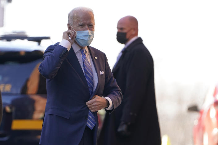 President-elect Joe Biden puts his finger on his ear as reporters shout question to him as he arrives at The Queen theater in Wilmington, Del., Monday, Dec. 7, 2020. (AP Photo/Susan Walsh)
