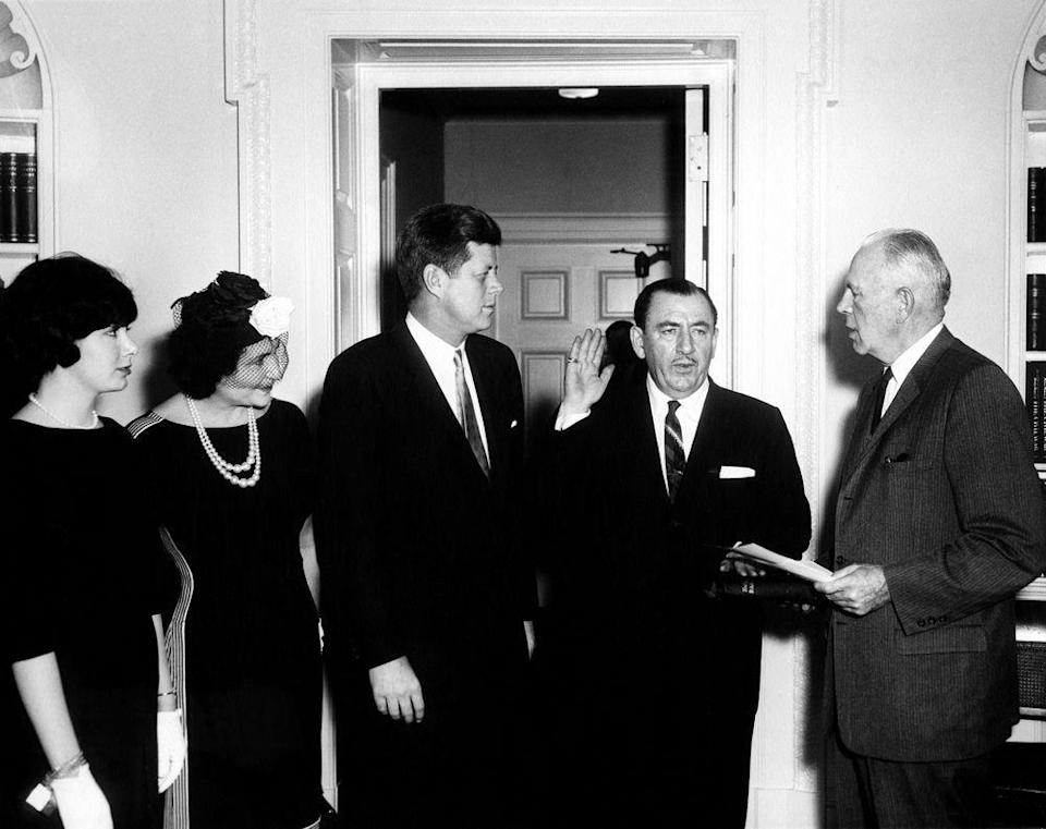 <p>Alongside JFK, Nancy D'Alesandro (later Pelosi) attends Thomas D'Alesandro, Jr.'s swearing in as a member of the Renegotiation Board.</p>